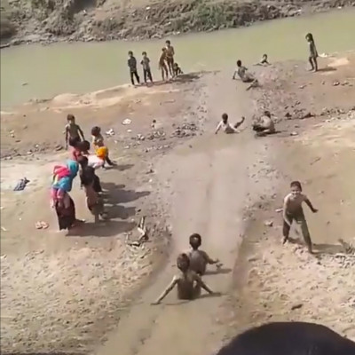 In the picture you can see the children walking along the road from the bank of the river. It is a beautiful game that we played in our childhood. Looking at this game reminds us of that memory.Children play this game in the Marich Apa river in Balitha village