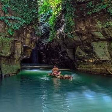 Debotakhum is located in Roangchhari upazila of Bandarban district.  Natural Bandarban is said to be the paradise of Khum and the crown of excellence of this kingdom will undoubtedly go to Devatakhum.  According to the locals, this khum is about 50-60 feet deep and 600 feet long which is much bigger than Velakhum and much more wild.  If you want to go to Devtakhum, first you have to go from Roangchhari to Kachhapatli Army Camp and trek to Shilbandha Para (Liragaon) with permission.  Of course, a strong bamboo valve should be made from the sealed area.  Going to Shilbandha, you have to cross Pong Su Aung Khum first.  Devatakhum begins after Pong Su Aung Khum is crossed.  To the locals it is Sonakhum.  Many also call it Thanchikhum in Marma language.  Devatakhum's trail is as beautiful as it is terrifying.  In the rainy season, as the trail jhiri / mountain will catch your eye, there is a risk of slipping on the slippery rocky path and falling into great danger step by step.  No noise, out of network.  Silent silence all around, like a haunted environment.  The environment will feel more haunted by the sound of boiling water.  The path has gone through the middle of two huge mountains which you have to give by raft.  You can enjoy nature up close here.  As if to merge with nature.  The way to go will tell you - how beautiful the way to heaven can be. Impossible kind of adventure, perfect deity to frighten the mind.  Trekking, Adventure, Risk, Vela Kayaking is a combo package of everything.  Absolutely outside the network, a different environment.  All around is quiet.  There will be the sound of water gushing from above, the sound of their own raft and the echo of your words!  The surroundings are so spooky and quiet that it will really give you a feeling of real adventure.  This khum (hole / where water accumulates) in the middle of two big hills is very dark on the inside.  Sunlight is very narrow. The way to Devtakhum Bandarban is the first place to go from anywhere in Bangladesh.  Things to keep in mind Go to Kachpatali and report to the army camp with a guide.  Two photocopies of National Identity Card / Passport must be kept It is better to tell the guide in advance about the raft to go around Devtakhum.  There will be problems in the network Only Robi / Airtel network will be available in Kachpatali !!  But on the wayfrom there to Khum you will be completely out of the network. If you don't have trekking with you, buy it.  It will cost 120-140 rupees.  You will find it in Bandarban. On the way to Devtakhum you will find a fountain called Shilbandha Jharna.  Be sure to check out the fountain on the way.  The real beauty of Khum can be seen in the rainy season.  However, trekking after the Shilbandha waterfall is very challenging because the waterway is very slippery.  So it is better to be mentally prepared in advance. It is better for new trekkers to avoid the rainy season because its trail look can be terrible for you in the rainy season.