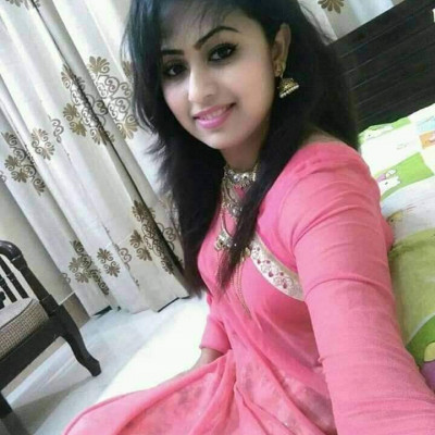 The picture shows a beautiful girl.  The girl is very beautiful to look at.  She looks more beautiful in a sweet colored sari.  Black thick hair on the head, drawn eyes look more beautiful.  She is sitting in her room.