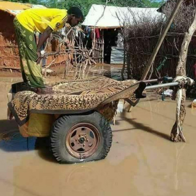 No specific place is required for prayers.  Prayers can be performed only if the mind has the intention.  The picture shows a man standing on a wheelbarrow praying.  He is praying despite all the places being submerged in the flood waters.