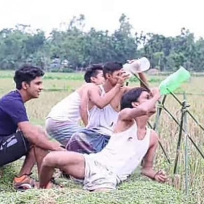 The picture shows the boys in the rural areas of Bangladesh. The boys and girls of Satkhira Sadar Thana Zeyala village are trying to survive with binoculars.
