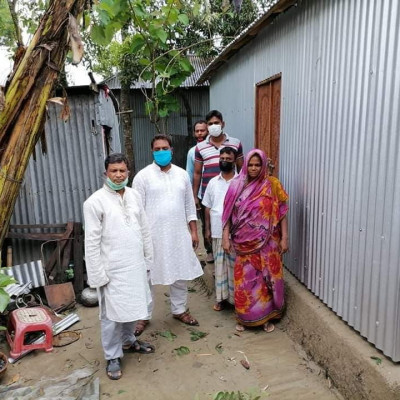 By the grace of Allah, the construction of another house was completed before Eid and the keys were handed over  Thank you Upazila Vice Chairman Basar Bhai for giving me the key  Thanks also to all the members of the Saturia First Group for their support during this Corona virus epidemic.  Place Tarali village of Shyamnagar police station.