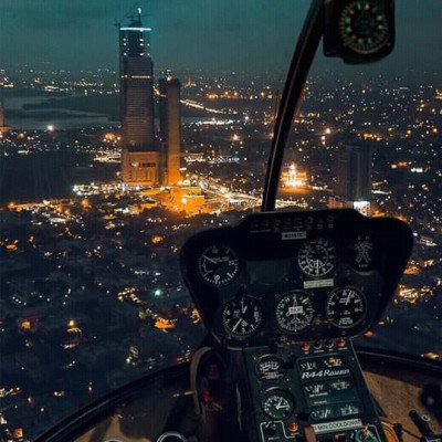 You can see this city at night and you can see this city flying around in a small helicopter and because of that it may have uploaded this picture from inside but you can see a lot of lighting in the city and the houses are very beautiful.