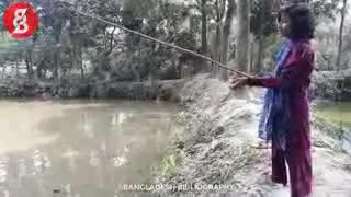 Fishing with fishing rods in the village pond