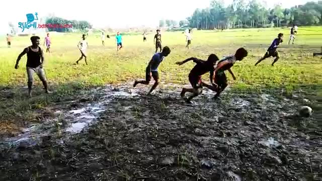 Village-football-game scene