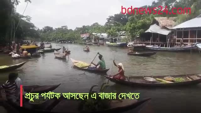 The floating market can be seen on the boat