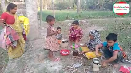 Here is a scene of small children cooking in the village