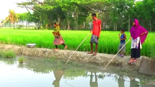 A video of rural Bengali boys and girls fishing with a sip