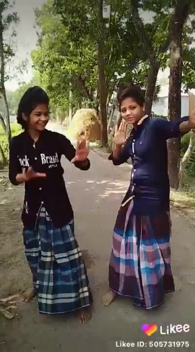 Two girls are dancing in lungi