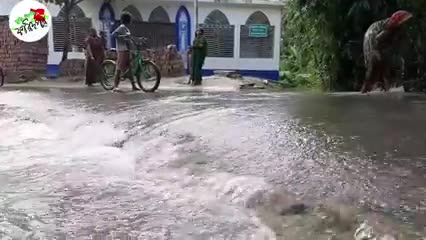 In Sirajganj, the houses of the village are being submerged by the rising water of Meghna.