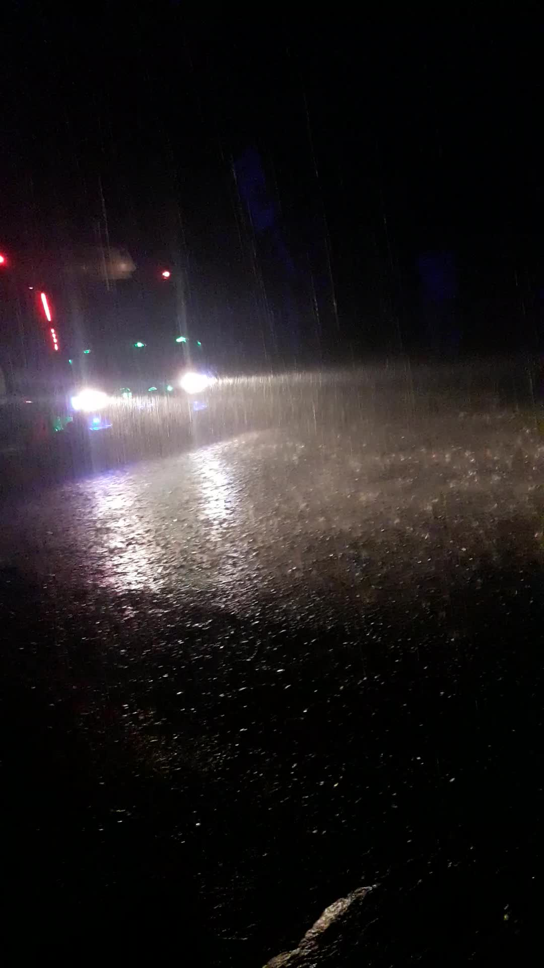 It has been raining in Khulna since evening. The video of this rain has been made from Khulna Main Road in the dark of night