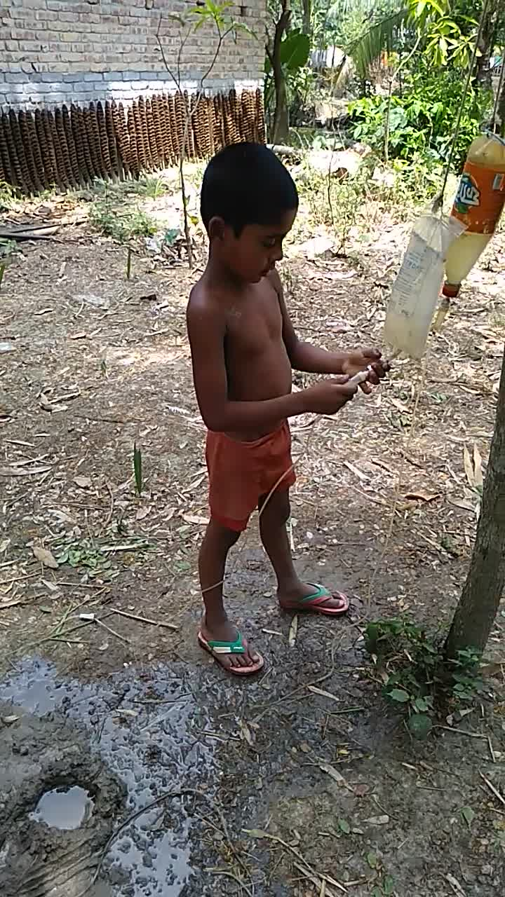 video of a child playing with water