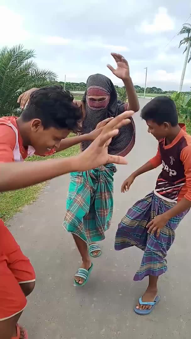 How are you all friends we can see in the video above 3 talented children of Satkhira district are dancing beautifully on the street.  They made the video in their spare time at the School College of Arthritis.  They always make short videos to have fun, they make videos like they have fun themselves and they also have a lot of fun from this video genre.  Friends, you must see that the dance wearing lungi looks very beautiful.  We should see some children dancing inside the village to have fun.