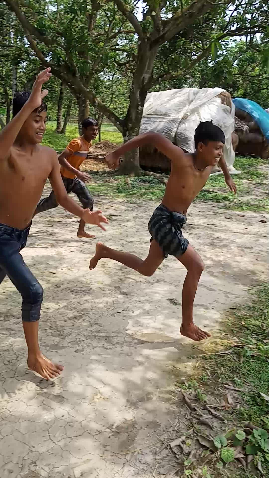 Good afternoon friends, friends, we can see the video of the funny video of some boys taking a bath inside a village in Satkhira district.  Friends, we can see three boys from the village jumping into the pond to take a bath from inside the green trees.  Friends, the boys of such villages take a bath by jumping into the pond with constant joy.  Friends, it is very important for people to take a bath because taking a bath makes the human body cold. Therefore, it is necessary to take a bath regularly for a healthy human body.  Fifteen bathing scenes that are not seen anywhere else in the city. The people of our country and abroad are fascinated when they see the scene where the boys of our village take a bath.
