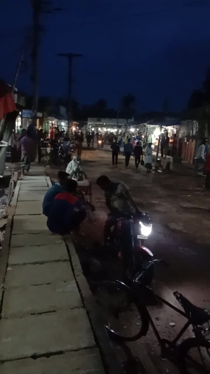 It has a four-lane shop around the corner.  The gathering of shopkeepers, motorcycles, cars, many bicycles, people move.  Dhuliar Bazaar, a beautiful place on the side of the road from Satkhira to Ashulia, seems to captivate the mind.