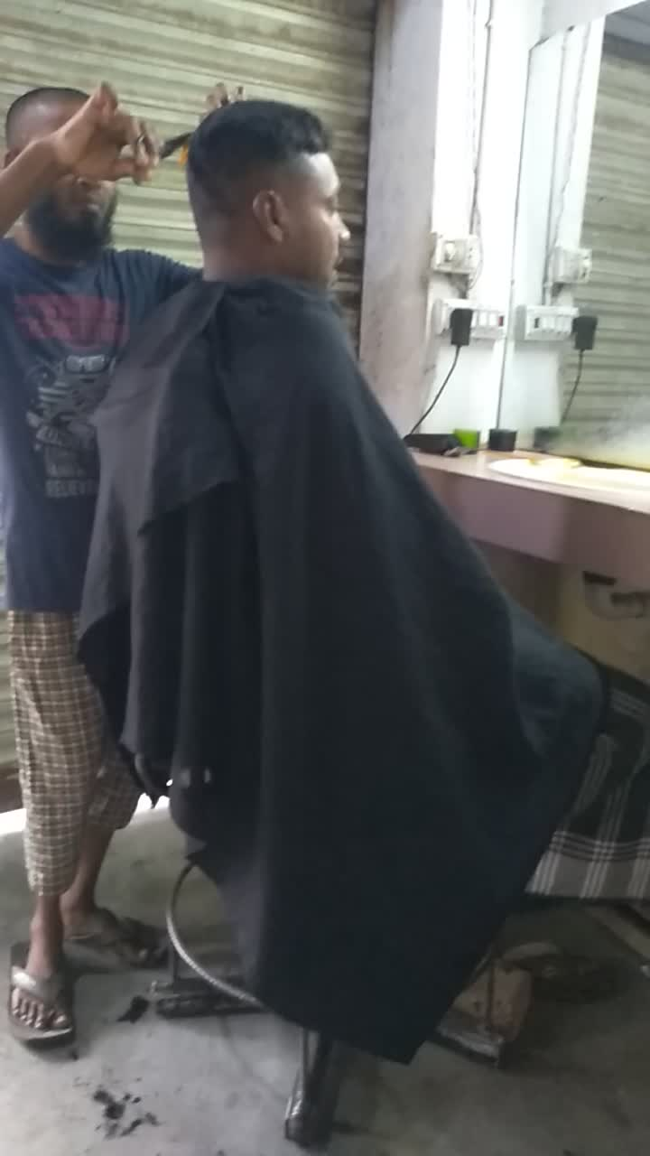 a video of hair being cut