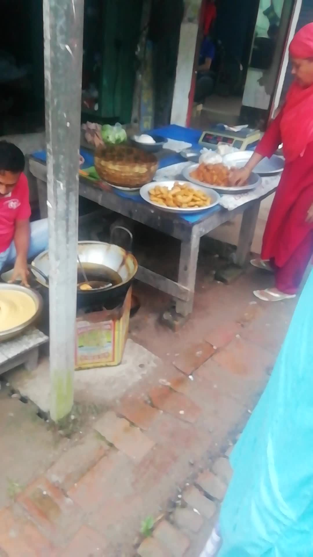 This man sells fried food in Satkhira district town