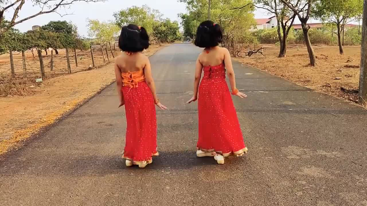 Two girls are standing on the street and dancing beautifully