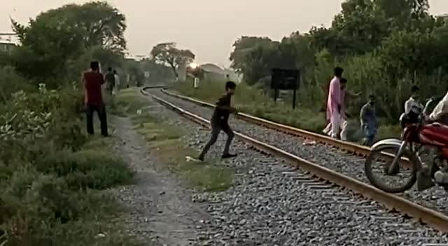 The video you see on the screen is a video of a railway line led by a boy chasing a goat to save it.