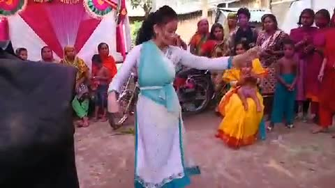 A girl is dancing beautifully at a wedding ceremony.