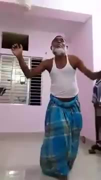 An uncle is dancing to the song.