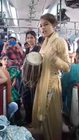 The video you can see on the screen is a video from inside the railway line and two or three girls are playing drums and singing to that rhythm.