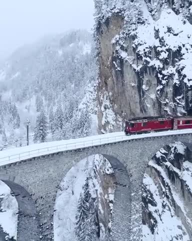 You can watch this video of this amazing train ride with white snow all around.