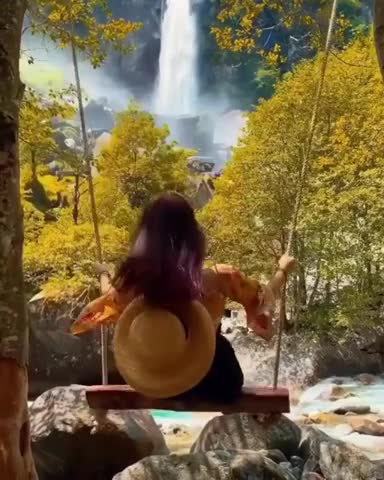 This girl is enjoying the amazing beauty of this natural environment and is very beautiful.