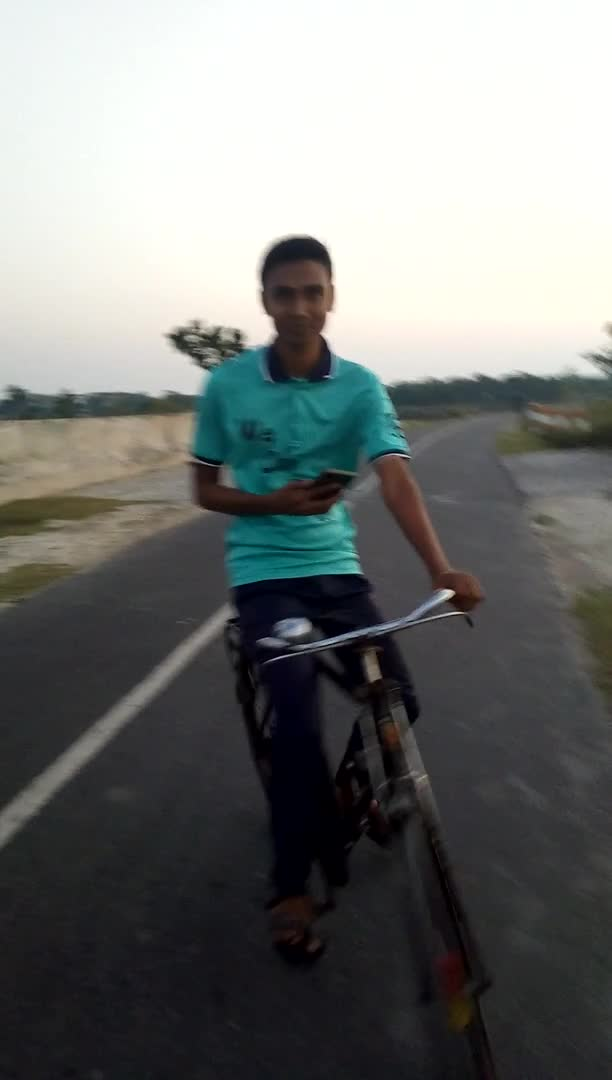 A scene of him cycling on Asashuni Bypass Road