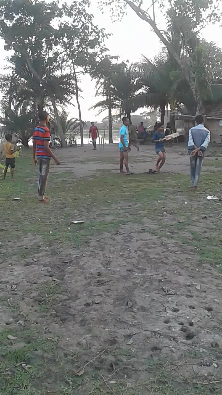 Village boys playing cricket