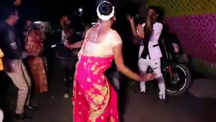 Everyone dances together at a friend's wedding on a winter night.