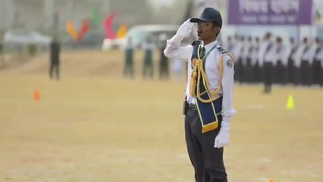 a video of school students caring in dhaka cantonment to honor the prime minister