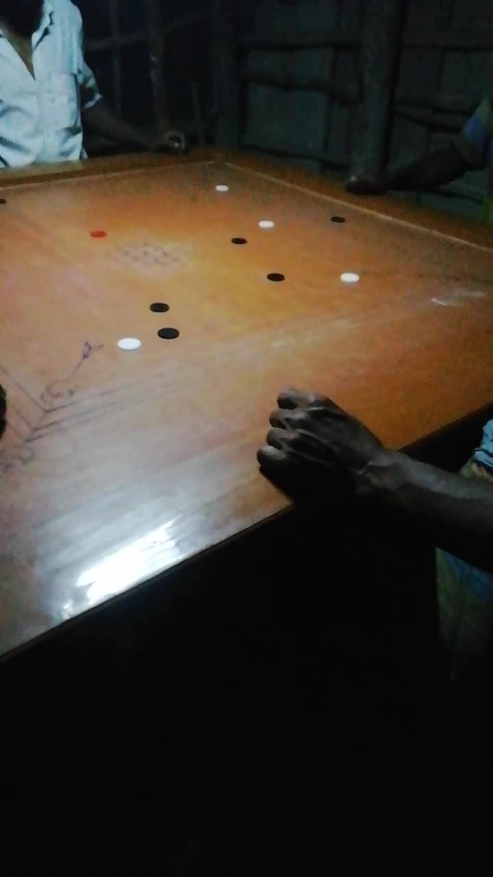 A video of him playing bod in a shop in Jayala village