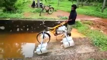 A student of Satkhira Government College set up a shelf and made a device for cycling while floating on the water.