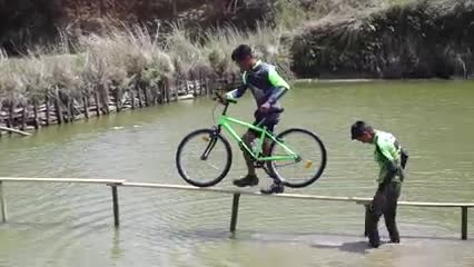 Video scene of cycling game on beautiful water.