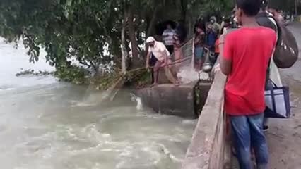 Video scene of fishing in the river of a beautiful village