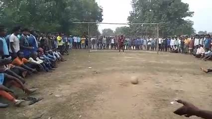 Video footage of playing football gold in a beautiful village.
