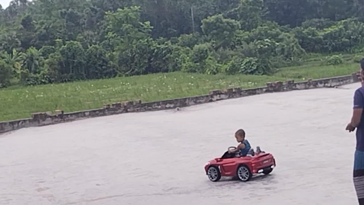 A little girl in a car.Made by plastics.