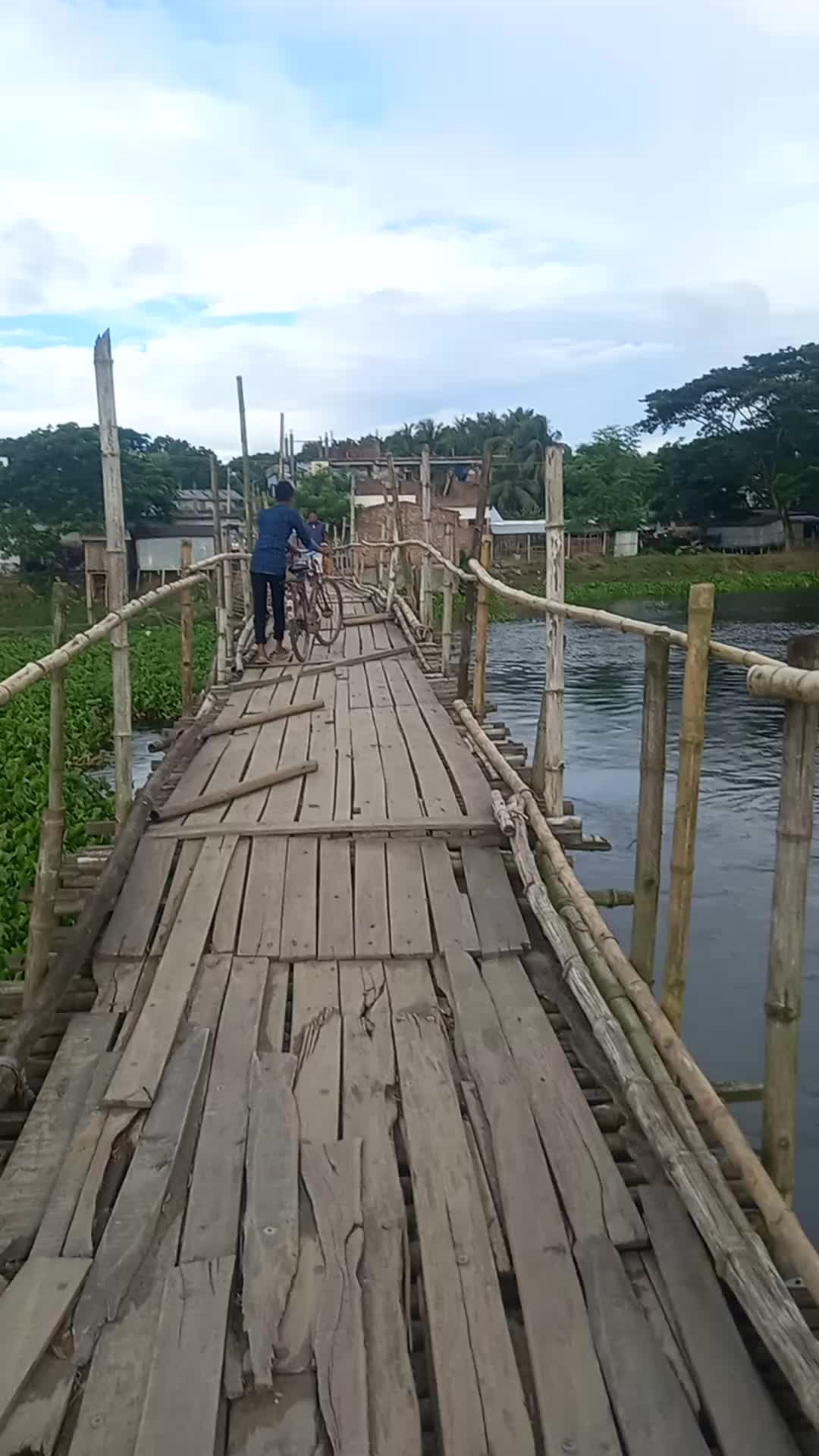 I showed you a view of a beautiful bridge on the bank of a river. I showed you a scene where some people built a small bridge and made a place to walk in the middle of the river.