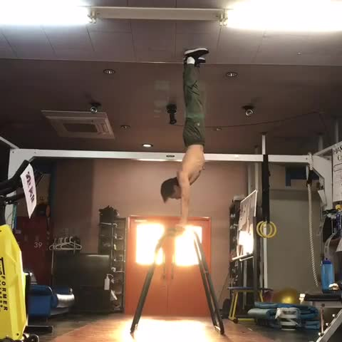 Hand stand on the parallel bar.