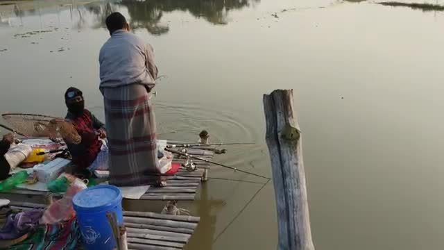The man was Fishing village of pond.