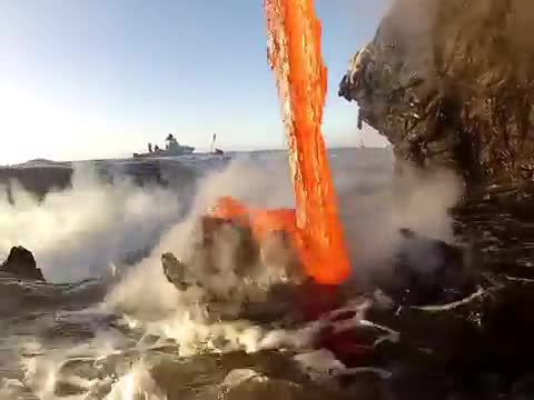Volcanic lava can be seen how molten lava is falling into the ocean.