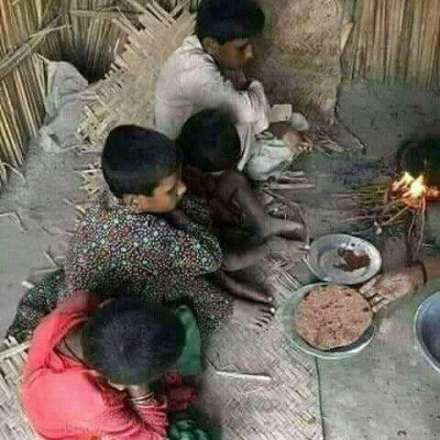 People from poor families can't eat twice a day. They have to live with a lot of hardships. Here you can see two or three boys and girls sitting. They are making burnt bread.