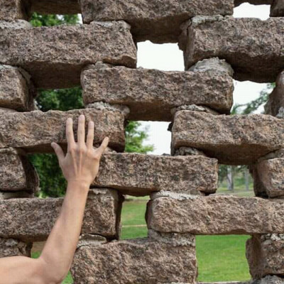Here this man is making a wall with his own hands and the wall shows some pakistan and one brick after another and arranging a little more space maybe to increase it a lot and maybe to make it better maybe he is building it very nicely  Doing